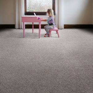 Girl playing piono on carpet flooring | Budget Flooring, Inc.