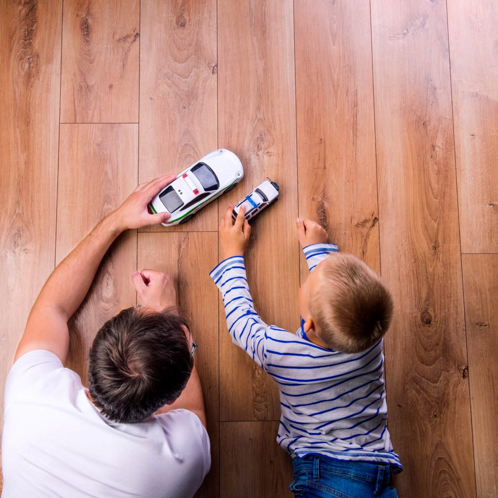 Father and kid playing with toycar | Budget Flooring, Inc.