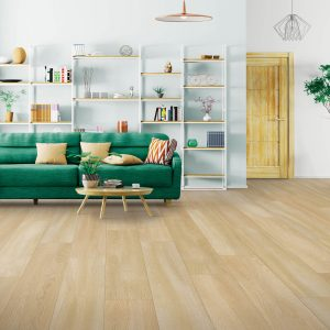 Green couch on floor | Budget Flooring, Inc.